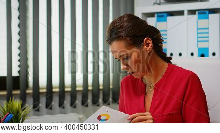 Close Up Of Lady Reading On Clipboard Checking Annual Statistics. Entrepreneur Working In Modern Pro