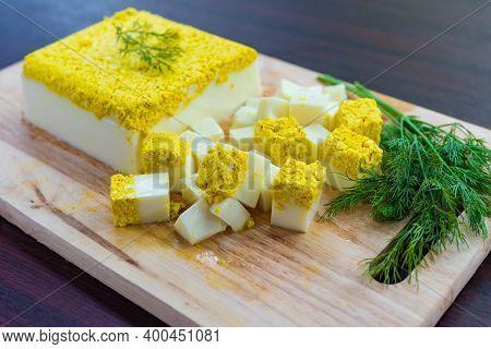 Side View, Vegetarian And Vegan Egg, Milk And Agar Agar, Tofu Yolk And Black Salt With Turmeric, Egg