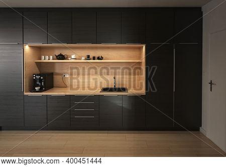 Modern design black kitchen in a nice room interior. 3d Rendering