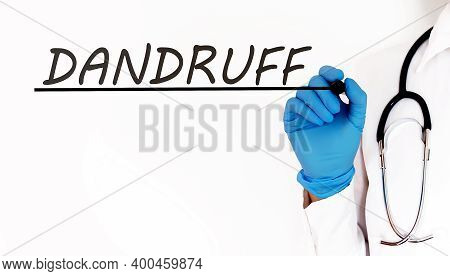 Doctor Writing Text Dandruff .medical Concept On White Background