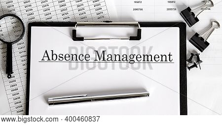 Absence Management Written On The Paper With Office Tools