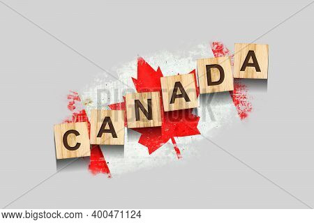 Canada. The Inscription On Wooden Blocks, Against The Background Of The Flag Of Canada. 3d Illustrat