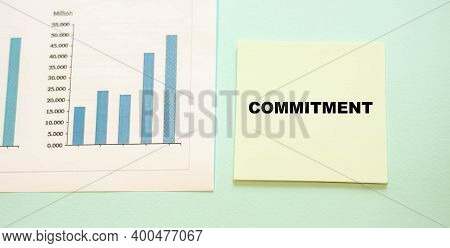 Commitment Word On Paper On A Growing Chart Background. A Promise To Lenders, Businesses And Familie