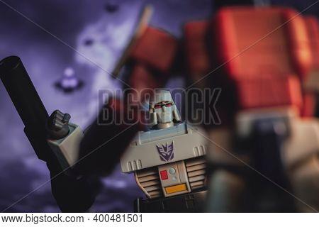 DEC 21 2020: Transformers Megatron battling Autobot leader Optimus Prime on Cybertron - Hasbro action figure
