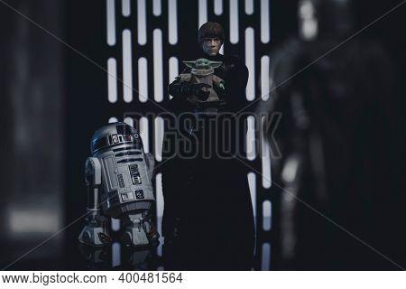 DEC 20 2020: a scene from Disney Plus The Mandalorian Season 2 finale with Jedi Luke Skywalker and R2-D2 taking Grogu from Din Djarin  - Hasbro Action Figure