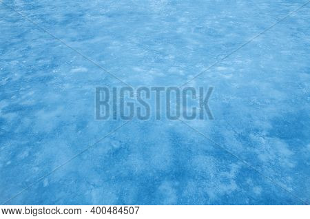Ice Blue Background. Frozen Water, Sea. Frosty Uneven Ice Texture In Winter.