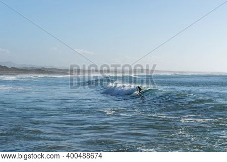 Sines, Portugal - 20 December 2020: Surfer Enjoying A Surf Session At Sao Torpes Beach In Sines On T