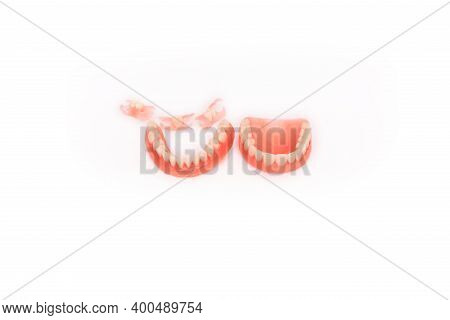 Dentures On A White Background. Close-up Of Dentures. Full Removable Plastic Denture Of The Jaws. Pr