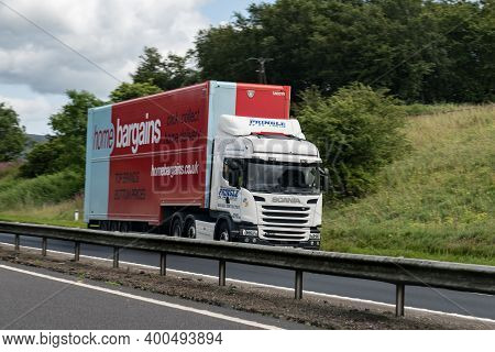 Scotland - August 12, 2019: Scania G450 Truck With A Trailer Of Home Bargain Company On A Scottish H
