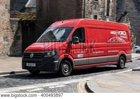 Stirling, Scotland - August 13, 2019: Red Volkswagen Crafter Delivery Van Of Parcel Force Worldwide