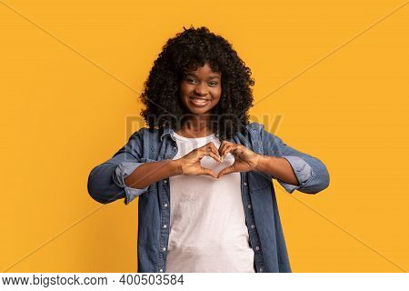 Beautiful African American Lady Smiling At Camera And Showing Heart Symbol, Holding Hands In Heart S