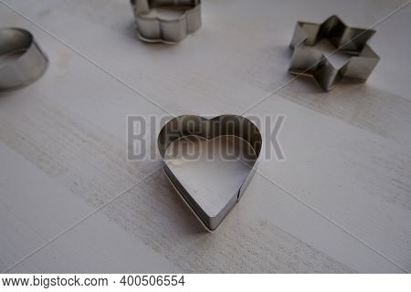 Silver Metal Heart-shaped Biscuit Cutter, Mold For Baking On White Background Across Other Shaped-bi
