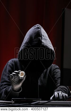 International Hacker Is Trying To Steel Your Crypto Currency. Blockchain Security. Thief With Laptop