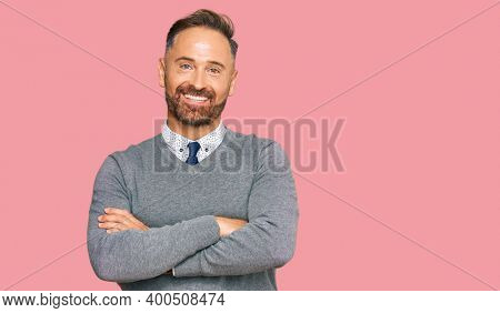 Handsome middle age man wearing business clothes happy face smiling with crossed arms looking at the camera. positive person.