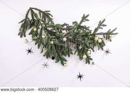 Spruce Branch Decorated With Christmas Decorations On The Wall Decorating The Interior For Christmas