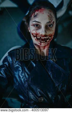 Portrait Of Woman In Image Of Ugly Bloody Mutant With Monstrous Teeth. Cosplay.