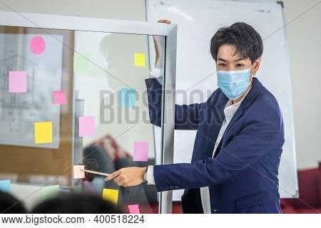 Asian Business Tomboy Lesbian Wearing Protective Mask Presenting Use Post It Notes To Share Idea.bra