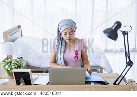 A Asian Women Disease Mammary Cancer Patient With Pink Ribbon Wearing Headscarf After Treatment To C