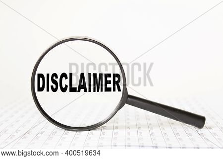 Words Disclaimer In A Magnifying Glass On A White Background. Business Concept