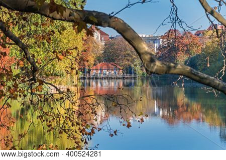Berlin, Germany - November 7, 2020: Park And A Listed Garden Lietzensee With Autumn Coloured Trees A