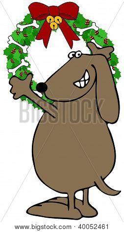 Dog hanging a Christmas wreath