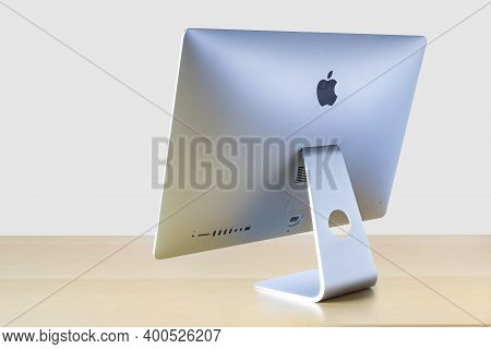 Calgary, Alberta, Canada. Dec 17, 2020. Perspective Rotated Back View Of An Imac Computer On A Woode