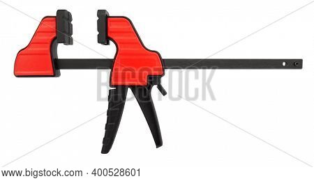 Spreader clamp features long clamping pads with anti-slip groove