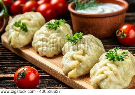 Traditional Manti Food On Plate, Top View. The Concept Of Oriental Cuisine. Uzbek Food Manty Dumplin