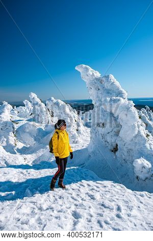 Woman Hiking In Winter Landscape Harz National Park Germany, Steam Train On The Way To Brocken, Famo