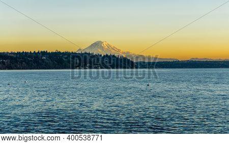 Mount Rainier Across The Puget Sound At Twilight. Photo Taken From Burien, Washington.