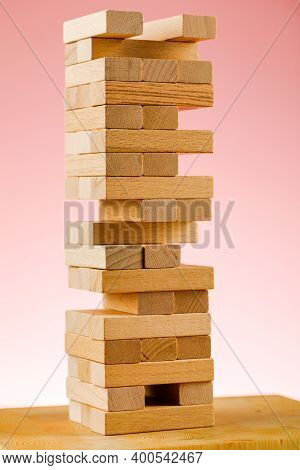 The Concept Of Entrepreneurial Risk. Wooden Blocks On A Pink Background