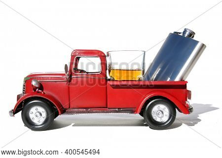 Red Pick Up Truck. Vintage Red Pick Up Truck with Whiskey or Liquor in the back. Red Truck with Hip Flask and Shot Glass of Whiskey or Liquor. Isolated on white. Room for text.