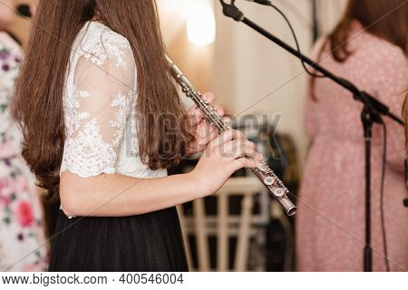 Flutist, Young Girl Playing The Flute, Hands, Fingers On Keys Closeup, Children Playing Transverse S
