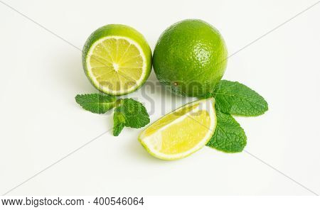 Lime Isolated.very Fresh And Sour Lime Slice With Mint Leaves Isolate On White Background.