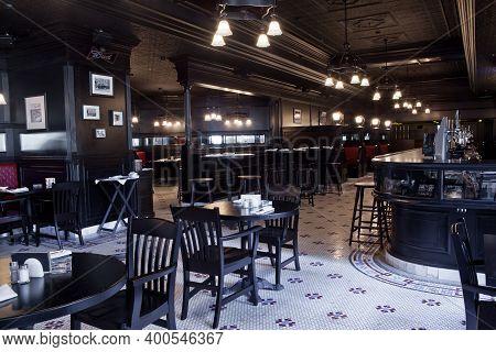 Moscow, Russia - April 04, 2012: Interior Of Irish Pub, Dark Colors, In Day, No Visitors, Staff. Res