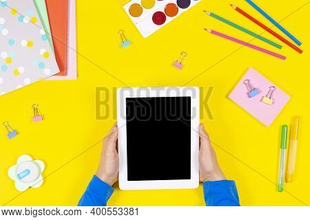 Online Learning, Back To School, Remote Education At Home. Kid Hands Holding Digital Tablet Computer