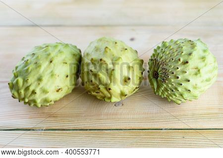 Annona, Custard Apple, Cherimoya, Sugar Apple On Wood Table Background. Annona Muricata And Other Pl