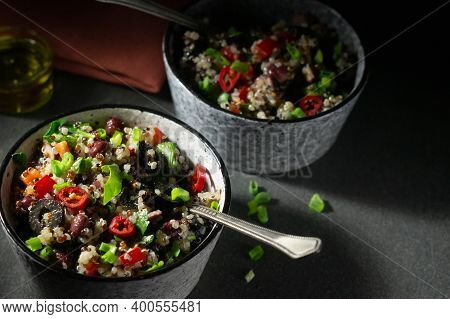 Two Bowls With Quinoa, Paprika, Beans And Olives