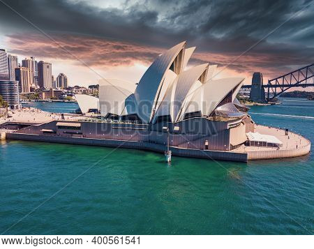 Sydney, Australia - August 22, 2020: The Sails Of The Sydney Opera House Beam White During Stormy Cl