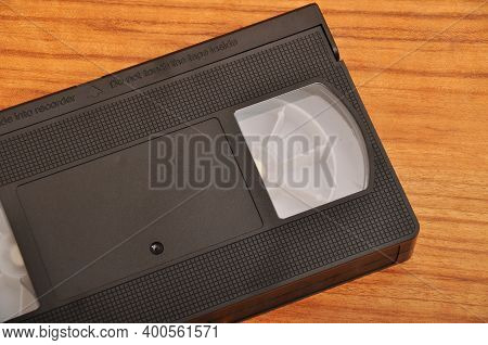 Old Blank Vhs Analog Video Cassette Tape Isolated On Wood Background