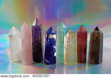 Healing Chakra Crystals On Halographic Background. Meditation, Reiki Or Spiritual Healing Background