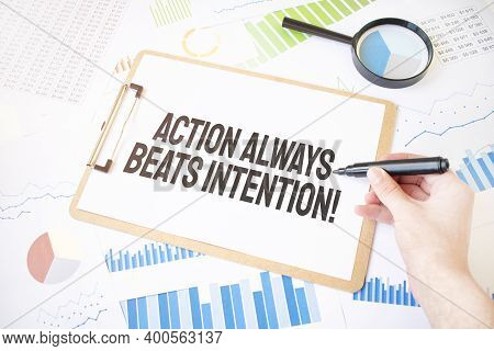 Text Action Always Beats Intention On White Paper Sheet And Marker On Businessman Hand On The Diagra