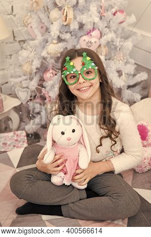 Adorable Gift From Santa. Happy Child Got Gift For Christmas. Small Girl Play With Toy Gift. Christm