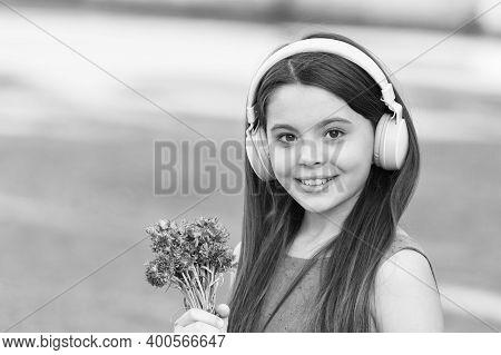 Baby Headphones. Happy Child Wear Headphones Outdoors. Small Girl Listen To Music In Headphones. Noi