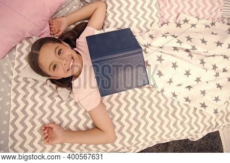 Fantasy Literature. Happy Girl Read Fantasy Book In Bed. Small Kid Enjoy Reading. Fantasy And Fantas