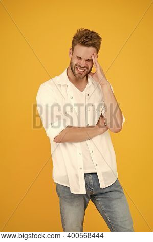 Having Headache. Young Handsome Man In Jeans Shirt. Guy Wearing Jeans And White T-shirt. Man In Whit