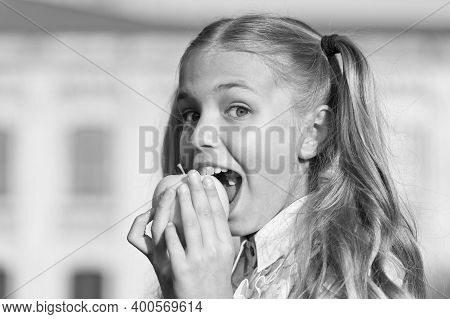 Eat For Health. Happy Child Bite Apple Outdoors. Natural Dieting. Dental Health. Oral Hygiene. Denta