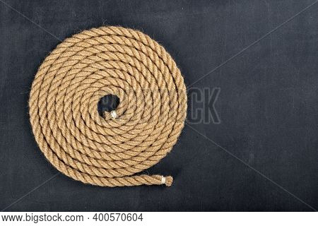 Thick Jute Rope Coiled In The Shape Of A Circle. Sailing Accessories Used On Yachts.