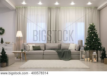 Elegant Living Room Interior With Comfortable Sofa And Christmas Decor