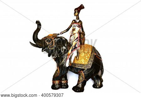 Figurine Or Souvenir, African Woman On Elephant In Miniature Isolated On White Background, Souvenir